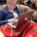 Photo: Student on couch using laptop computer