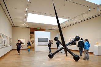 On Oct. 20, 2011, visitors view contemporary art in one of the third-floor galleries at the Chazen Museum of Art at the University of Wisconsin-Madison. Among the museum's new features are copper-clad north-facing light monitors that filter damaging ultraviolet rays and allow natural light in the galleries. The photograph was made during an open house for the campus community, which was followed by a weekend public opening. (Photo by Jeff Miller/UW-Madison)