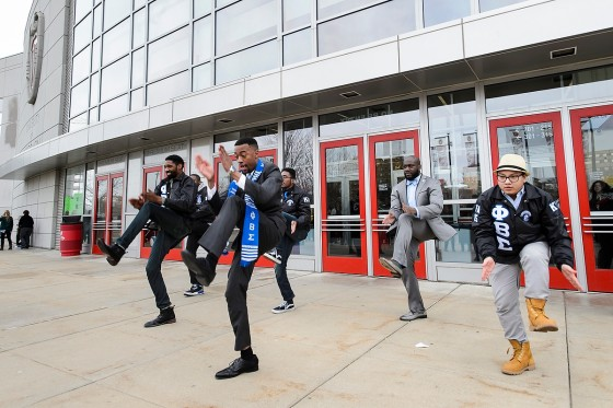 A graduate performs a step dance with his Phi Beta Sigma fraternity brothers following UW-Madison's winter commencement ceremony at the Kohl Center at the University of Wisconsin-Madison on Dec. 20, 2015. The indoor graduation was attended by approximately 1,200 bachelor's and master's degree candidates, plus their guests. (Photo by Jeff Miller/UW-Madison)