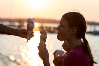 Gillett Salinas's family enjoys eating Babcock Dairy ice cream cones as the sun sets over Lake Mendota and the Memorial Union Terrace at the University of Wisconsin-Madison during a summer evening on July 26, 2014. (Photo by Jeff Miller/UW-Madison)