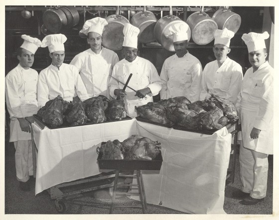 UW-Madison Chef Carson Gulley poses with his chefs and a number of roast turkeys to be served to students around Thanksgiving time in 1947.