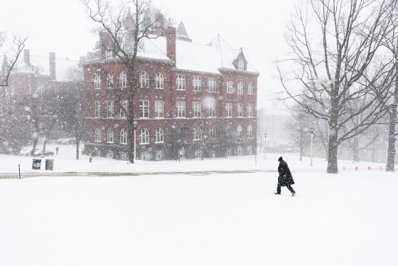 A pedestrian walks across Bascom Hill toward Science Hall at the University of Wisconsin-Madison during a winter snowstorm with whiteout conditions on March 1, 2016. (Photo by Jeff Miller/UW-Madison)