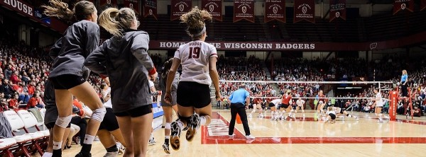Court-side Wisconsin Badgers volleyball players cheer on their teammates playing the Washington State Cougars during the second-round of NCAA Division 1 championship play at the Field House at the University of Wisconsin-Madison on Dec. 2, 2016. The Badgers won, sweeping the Cougars, 3-0, and advance to the sweet 16 NCAA regionals, to be hosted at the UW-Madison Field House on Dec. 9-10. (Photo by Jeff Miller/UW-Madison)