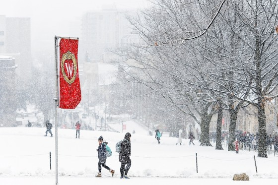 As a fresh coat of snow falls, students make their way to class at the University of Wisconsin-Madison during winter on Jan. 25, 2017. (Photo by Bryce Richter / UW-Madison)