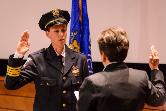 New University of Wisconsin Police Chief Kristen Roman, left, recites the oath of office to her predecessor, retired Chief Susan Riseling, during Roman's formal swearing-in ceremony at Union South on Feb. 1, 2017. (Photo by Jeff Miller/UW-Madison)