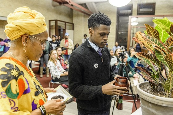 Hazel Symonette, left, program development and assessment specialist in the Division of Student Life, and Marquise Mays right, chair of the Wisconsin Black Student Union, perform a libation pouring ritual in memory of those who have passed on during a dedication and libation ceremony for the new Black Cultural Center.