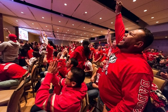 On April 6, 2015, hundreds of Badger fans cheer in excitement in Union South's Varsity Hall at the University of Wisconsin-Madison as they watch the Wisconsin men's basketball team take on Duke in a televised NCAA tournament championship game being played in Indianapolis, Ind. The Duke Blue Devil's went on to win, 68-63, during the final minute of the game.  (Photo by Jeff Miller/UW-Madison)